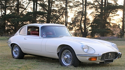 Sun setting behind Jaguar E-Type